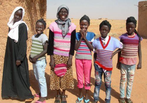 Kinder mit Stricksacken Abu Rof